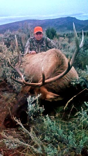 Hunter and his elk.jpg